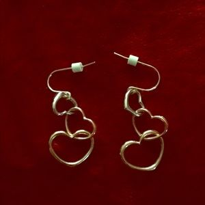 Tricolor heart earrings.